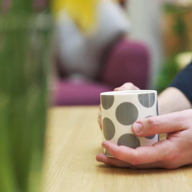 Hand holding a mug of tea